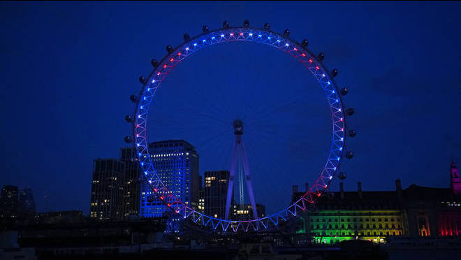 The London Eye lit up in Union Jack colours for Sir Captain Tom Moore.