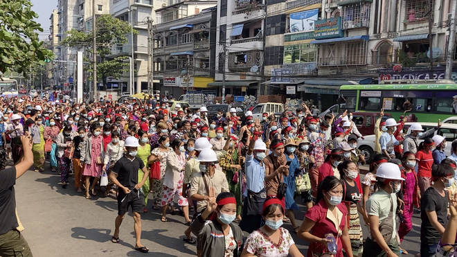 A crowd of protesters march in Yangon, Myanmar