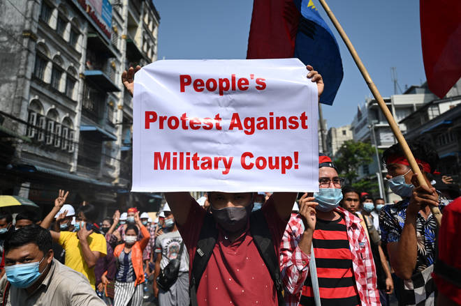 A protester holds up a sign during a demonstration against the military coup in Yangon