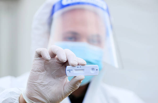 File photo: A lab technician holds a Healgen Covid-19 Rapid Antigen Test at RocDoc's testing facility in Gorey, Co. Wexford