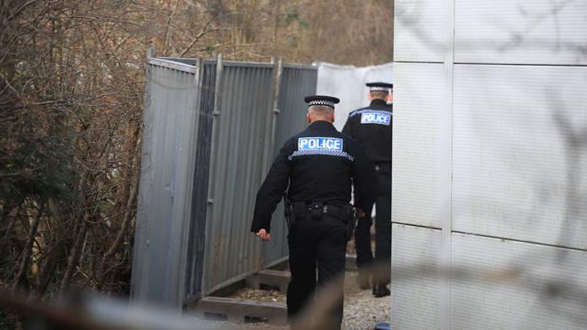 Police raid: Officers in Merseyside (file image)