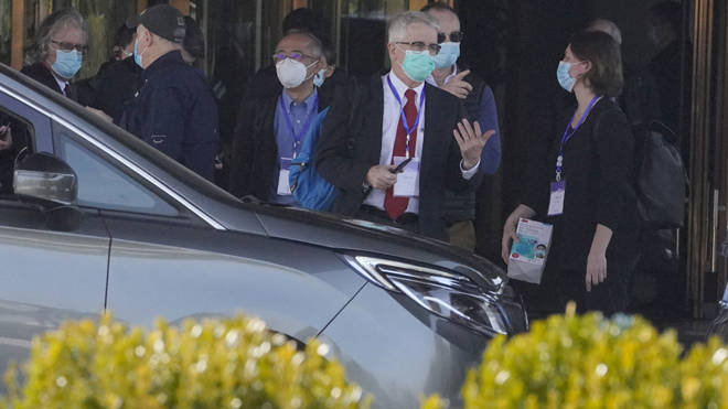WHO investigators pictured during an outing in Wuhan
