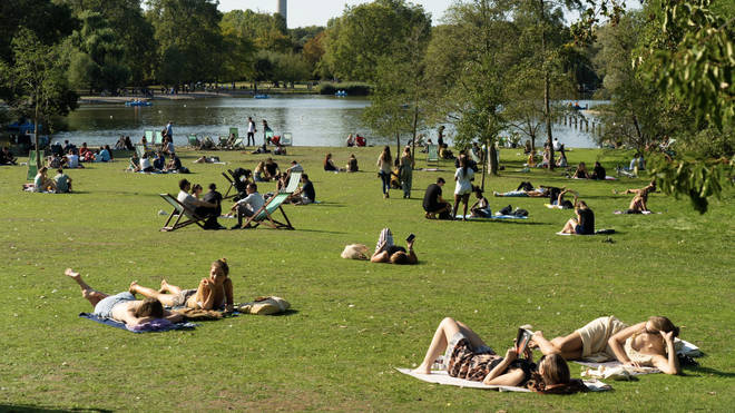 People in Regent's Park in London enjoy good weather