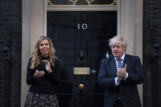 Prime Minister Boris Johnson and Carrie Symonds stand in Downing Street, London, to join in Clap for Carers