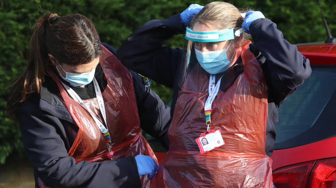 Members of Kent Fire and Rescue Service prepare to deliver coronavirus testing kits in Maidstone during a blitz on new variants