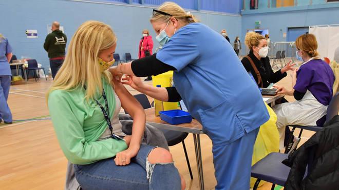 A coronavirus vaccination centre set up at Cwmbran Stadium, south Wales