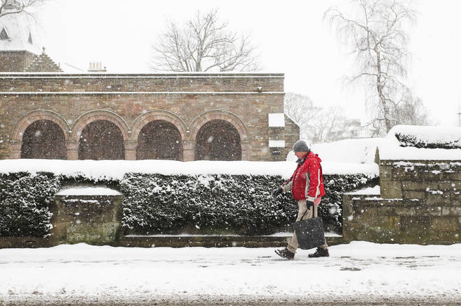 A member of the public walks through the snow in Kelso, Scotland