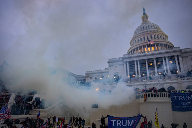 Tear gas is fired at supporters of President Trump who stormed the United States Capitol building