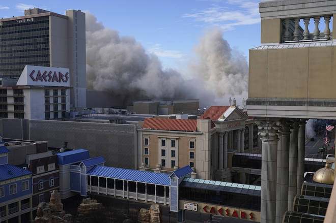 Dust fils the air after the former Trump Plaza casino was imploded