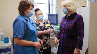 Camilla, Duchess of Cornwall, speaks with a member of staff during a visit at Queen Elizabeth Hospital