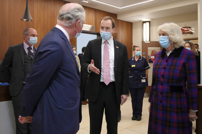 Prince Charles and Camilla, Duchess of Cornwall, talk with Health Secretary Matt Hancock
