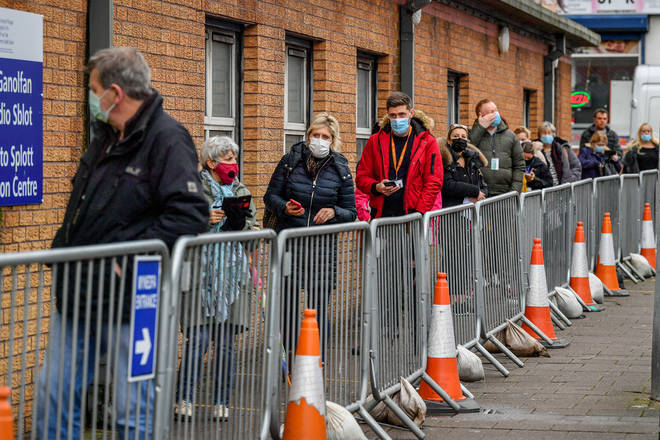 People queue for vaccines outside Cardiff and Vale Therapy Centre in Wales