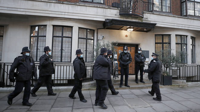Police officers stand outside King Edward VII's hospital in London