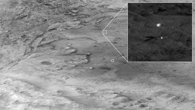 This black and white image shows the descent of Perseverance over Mars