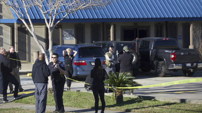 Jefferson Parish Sheriff's Office deputies investigate a shooting at the Jefferson Gun Outlet in Metairie, Louisiana