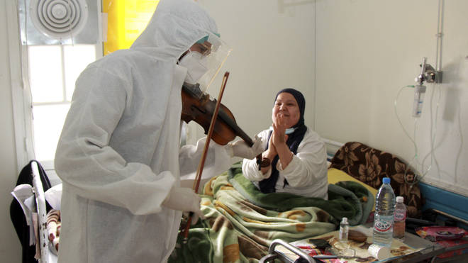 Dr Mohamed Salah Siala plays the violin for patients on the Covid wards of the Hedi Chaker hospital in Sfax, eastern Tunisia
