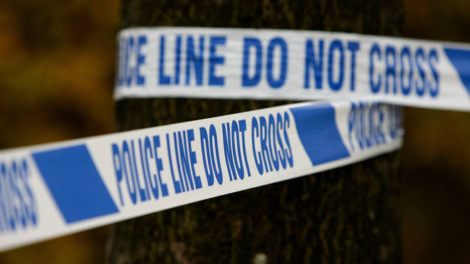 Police remain at a scene where a four-year-old child died in a housefire