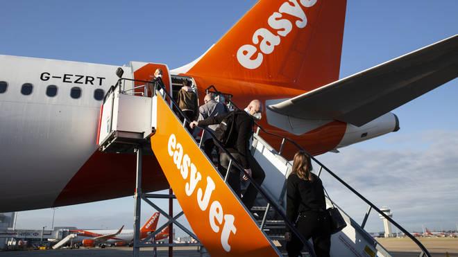 People getting on board a plane