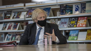Prime Minister Boris Johnson meets with teachers in the library, during a visit to Sedgehill School in Lewisham