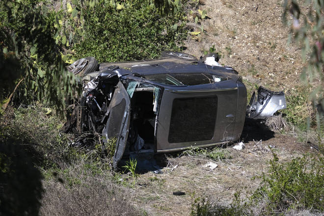 A vehicle rests on its side after a rollover accident involving golfer Tiger Woods