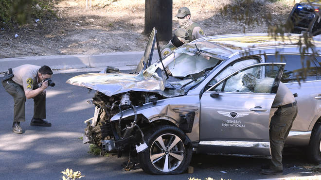 Tiger Woods mangled car is photographed by police after the crash