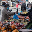 People shop at an outdoor fruit and vegetable market in Tooting in South Londo