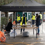 People have coronavirus tests at a temporary COVID-19 testing facility set up in Ealing