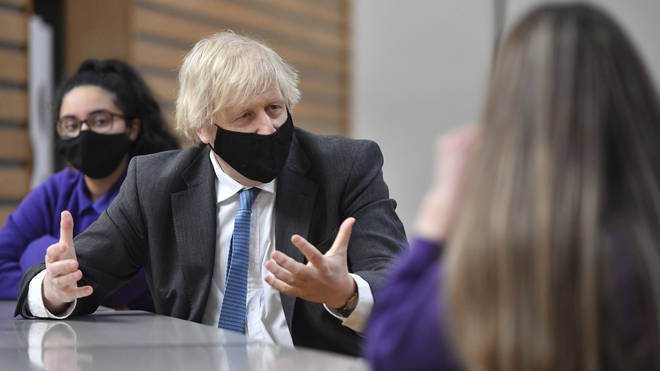 Boris Johnson meets with Year 11 students in the canteen during a visit to Accrington Academy