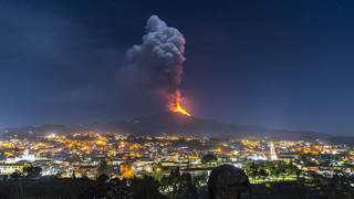 Flames and smoke billowing from Mount Etna