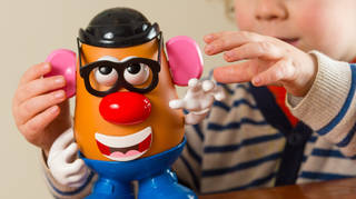 A child plays with a Mr Potato Head