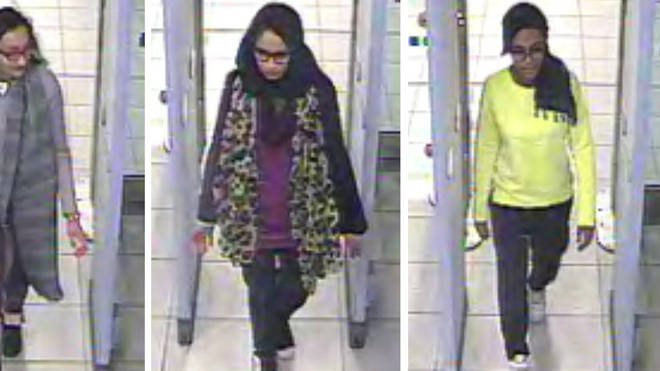Shamima Begum (centre) was captured on CCTV heading to Syria with Kadiza Sultana (left) and Amira Abase (right)