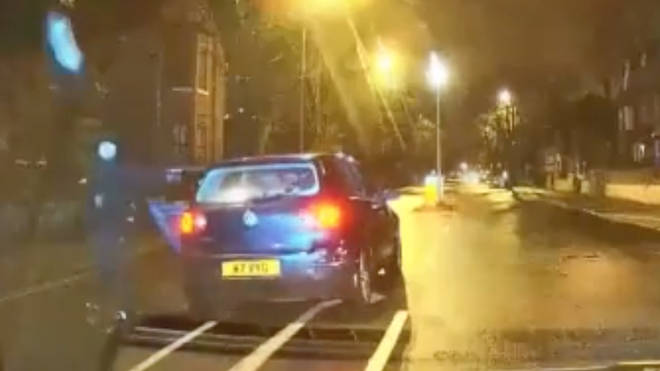 A man was arrested after throwing a stolen car parts at police in Manchester