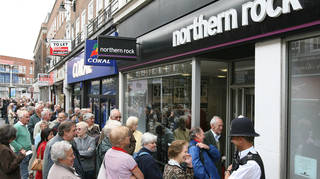 Northern Rock customers queue outside a branch