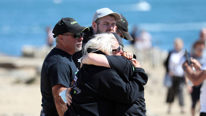 Harry's family embrace as they scatter his ashes