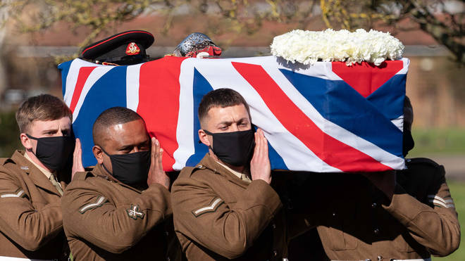 The coffin of Captain Sir Tom Moore is carried by members of the armed forces during his funeral