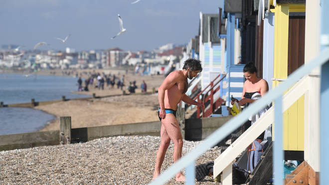 Crowds have gathered at beaches across England amid the warm weather