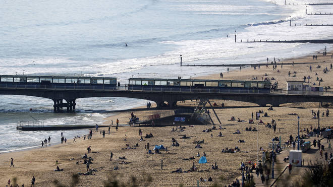 People relaxed at Bournemouth beach on Saturday amid wearm weather