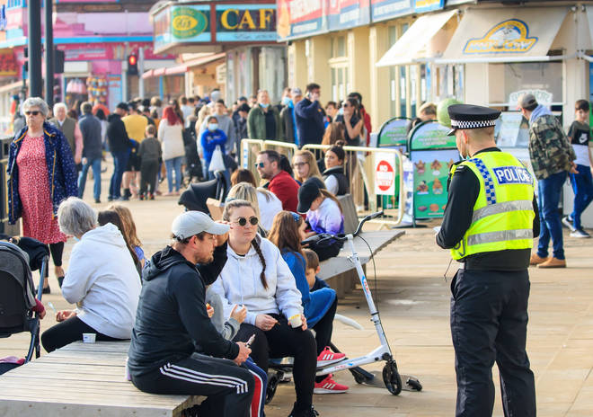 Police officers spoke to people in Scarborough, North Yorkshire, as crowds gathered