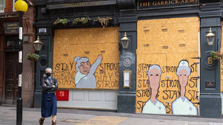 A pub is boarded up in Central London