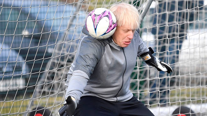 The Prime Minister pictured playing football in 2019