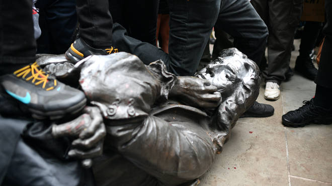 The Edward Colston statue at the feet of protesters