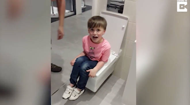Six-year-old Alfie became stuck in the toilet at a bathroom store