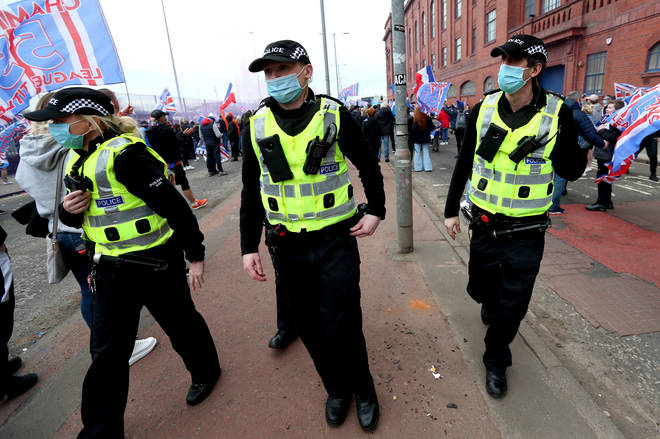Police were present at Ibrox Stadium and George Square but appeared to be unable to stop fans gathering in breach of lockdown rules.