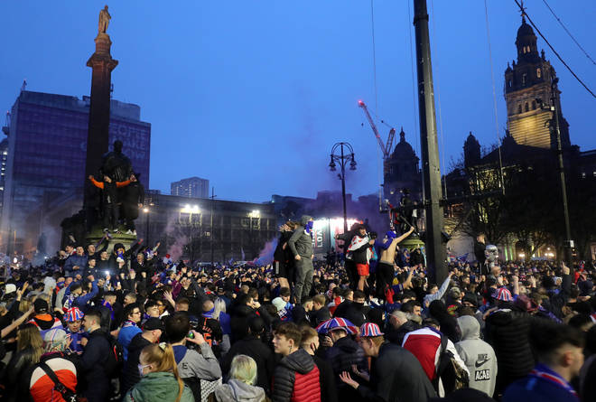 Rangers fans celebrate in George Square after Rangers win the Scottish Premiership title