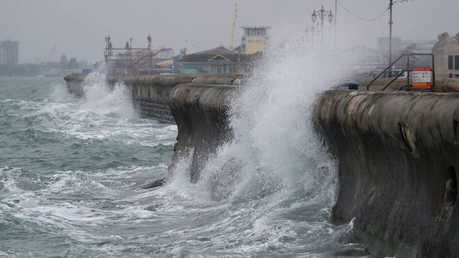 Waves crash against the sea wall along Clarence Esplanade in Southsea, Hampshire, on Wednesday