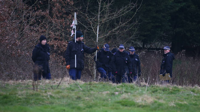 Officers are seen searching in Ashford in Kent