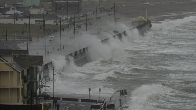 Waves crash the strand at Tramore in County Waterford on the South East coast of Ireland in high winds yesterday