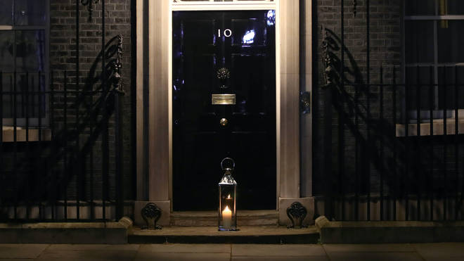 A large candle was laid on the doorstep of 10 Downing Street