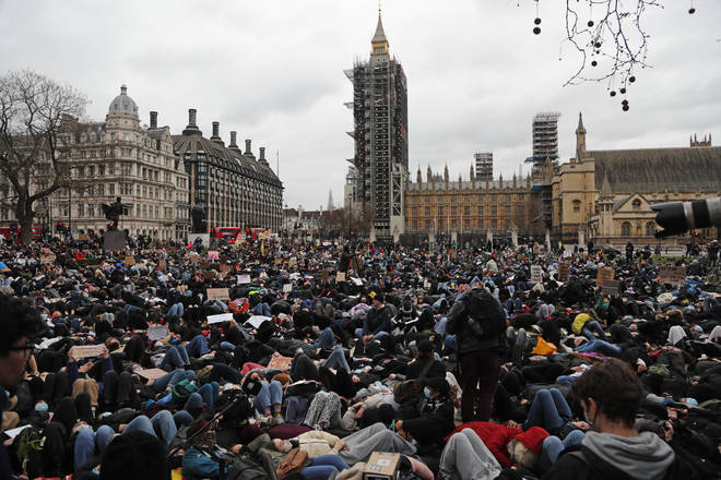 Thousands of protesters lay-down outside Parliament in memory of Sarah Everard.