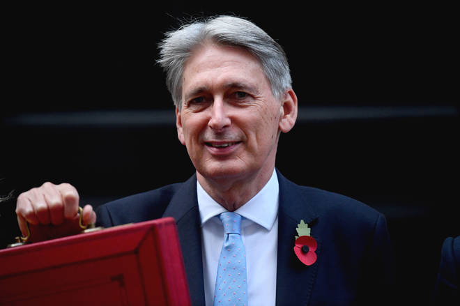 Philip Hammond holds up the Budget Red Box in Downing Street